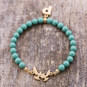 Pearl Charm Bracelet With Bird Detail