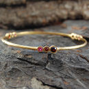 Gold Garnet And Ruby Triple Stone Bangle
