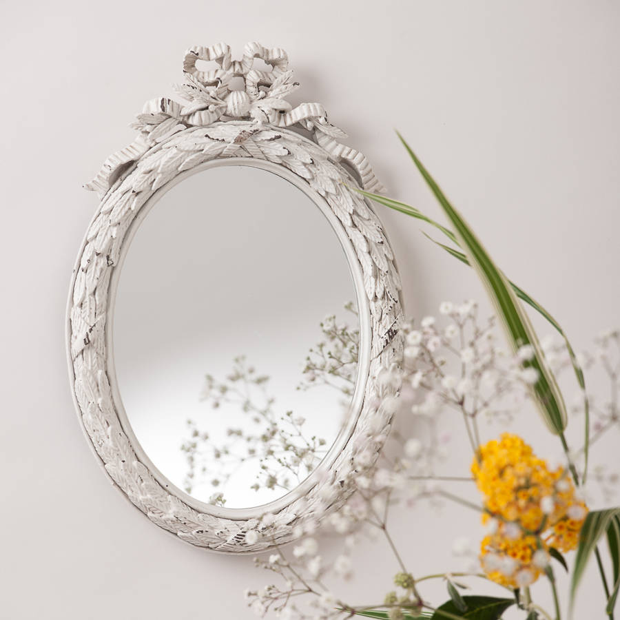 white oval vintage bow mirror by hand crafted mirrors | notonthehighstreet.com