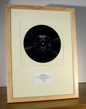 7-inch single mounted in natural wood frame