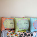 Large peachy orange, green and blue cushions