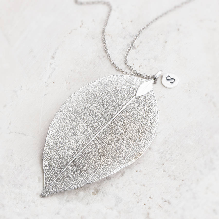 Elia leaf pendant necklace by bloom boutique notonthehighstreet silver with embossed charm mozeypictures Image collections