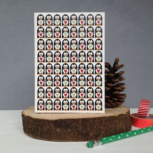 A Huddle Of Penguins Christmas Card