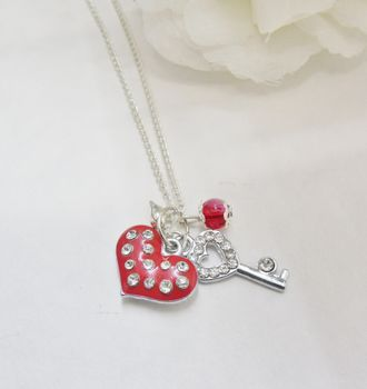 Red enamel and diamante heart and key