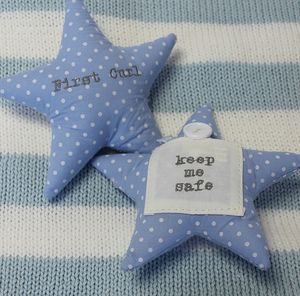 Pair Of Blue First Tooth And Curl Star Cushions