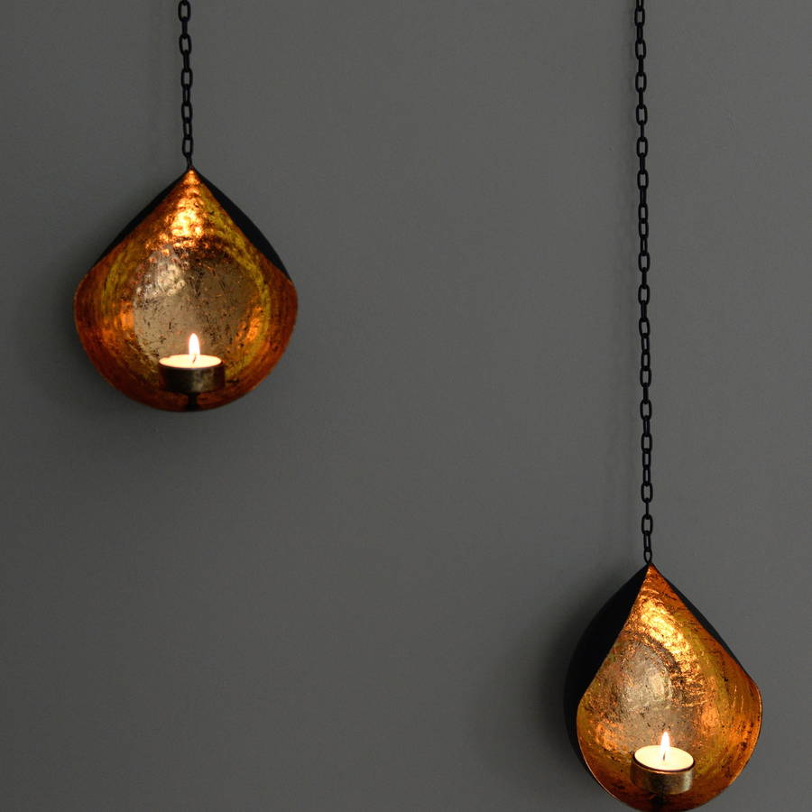 hanging gold and black tea light holder by the forest & co notonthehighstreet.com