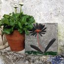 daisy tile with terracotta and green glass