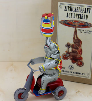 Vintage Tin Wind Up Elephant On A Bike
