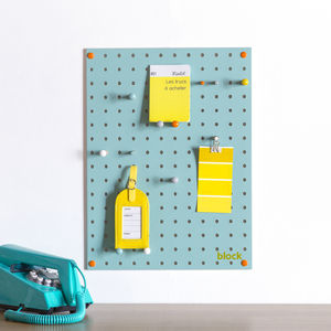 Blue Pegboard With Wooden Pegs