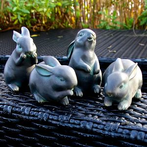 Four Little 'Bronze' Rabbits - sculptures & ornaments