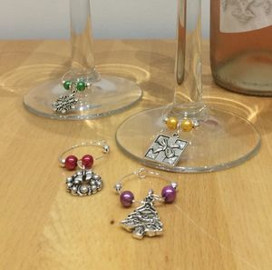Set Of Four Christmas Wine Glass Charms - drink & barware