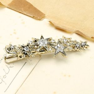 Crystal Starburst Hair Clip In Gold