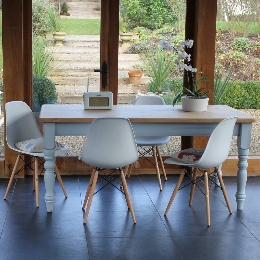 original painted farmhouse table with eames style chairs