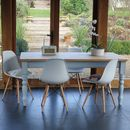 Painted Farmhouse Table With Eames Style Chairs