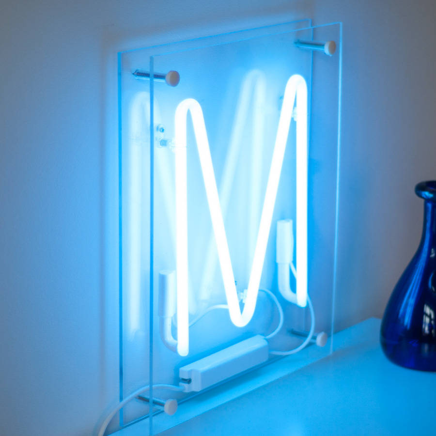 Letter Writing Official%0A Blue neon  u    M u     sandwiched in clear perspex