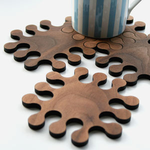 A Set Of Solid Walnut Jigsaw Coasters - new home gifts