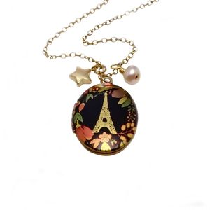'Love Conquers All' Eiffel Tower Locket