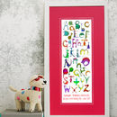 'Dinosaur Alphabet Print' - framed with red mount