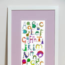 'Dinosaur Alphabet Print' - framed with pink mount