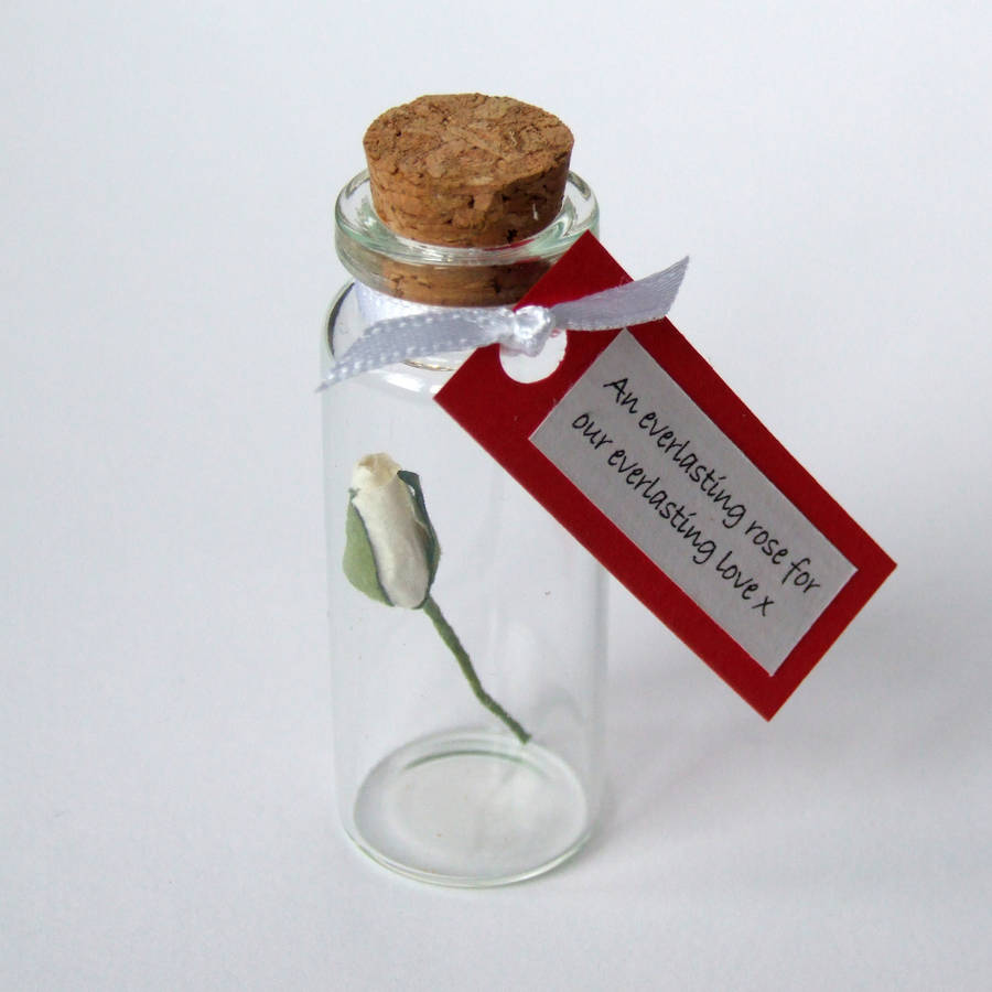 tiny single rose in a bottle with personalised message by made in ...