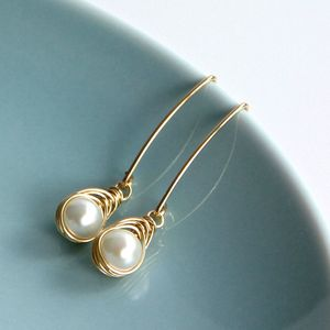 All Wrapped Up Pearl And Gold Long Earrings - earrings