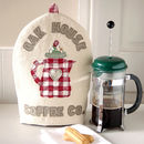 personalised house name coffee cosy, red trimmed