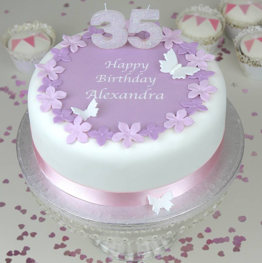 Birthday Cake With MAUVE FLOWERS PALE PINK RIBBON And GLITTER CANDLES