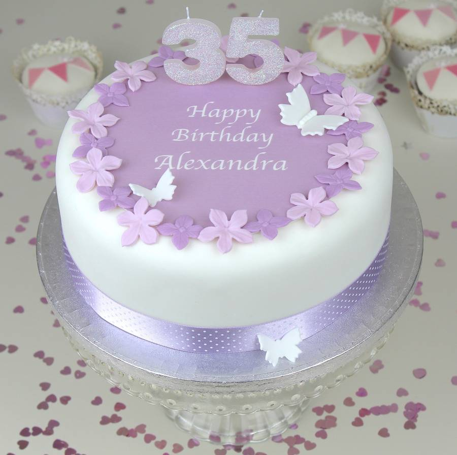 Birthday Cake With MAUVE FLOWERS POLKA DOT RIBBON And PALE GLITTER CANDLES