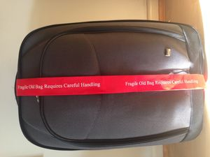 Fragile Old Bag Requires Careful Handling - travel & luggage