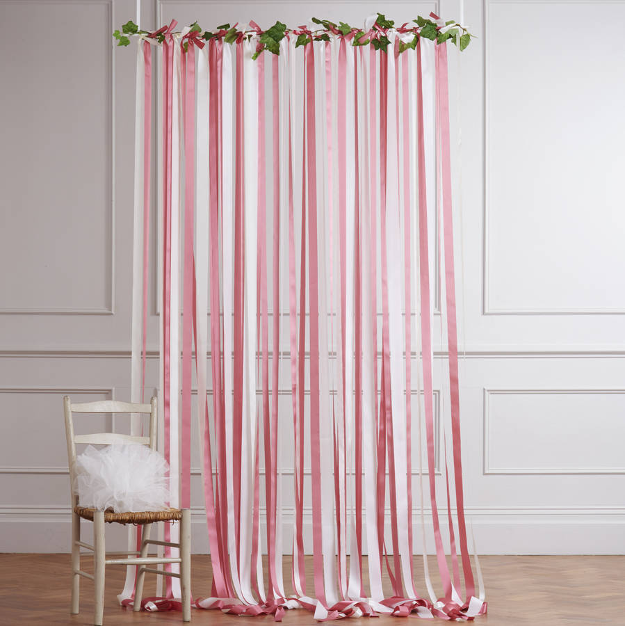Pink and cream ribbon backdrop on white pole with ivy by for Background curtain decoration