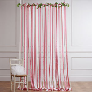 Pink And Cream Ribbon Backdrop On White Pole With Ivy