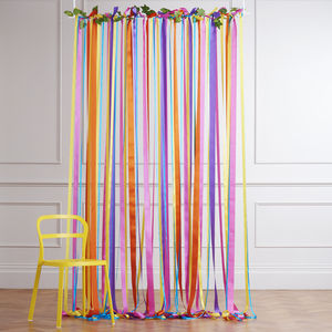 Rainbow Ribbon Backdrop On White Pole With Ivy Garland - backdrops
