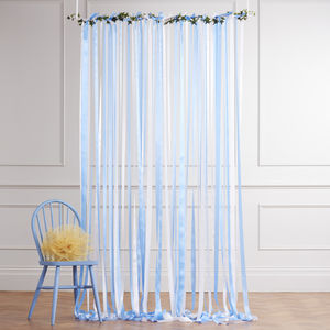 Blue Ribbon Backdrop On White Pole With Ivy Garland