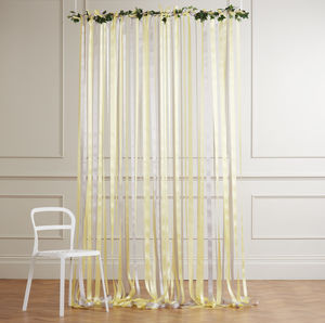Yellow And Grey Ribbon Backdrop On White Pole With Ivy