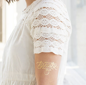 Metallic Gold Typography Tattoos - nail & body art
