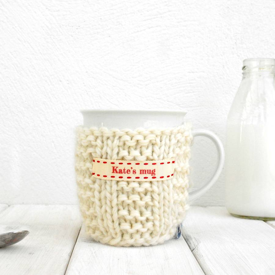 Personalised Knitted Mug Cosy Cream With Red Ribbon