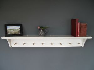 Traditional Cottage Style Shelf With Wooden Pegs - bedroom