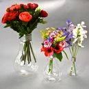silk ranunculus left, silk wildflower middle, sweetpeas right