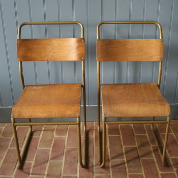 A Pair Of Industrial Metal Framed Chairs