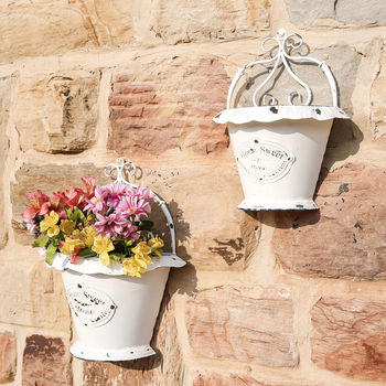 Set Of Two Floral Metal Wall Planters