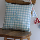 personalised cushion blue on chair