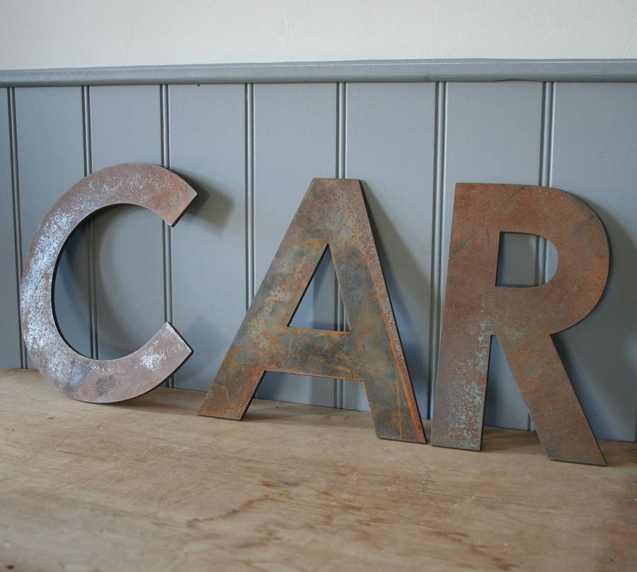 large metal letters by homestead store With large metal numbers and letters