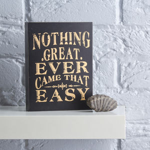 Black And Gold Wooden Sign