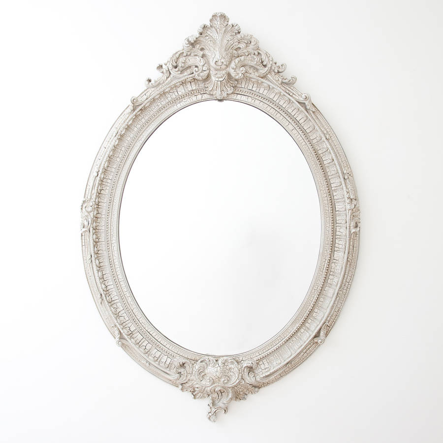 Opulent antiqued ivory oval mirror by decorative mirrors for Fancy oval mirror