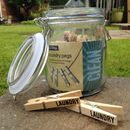 Laundry Pegs In A Glass Jar