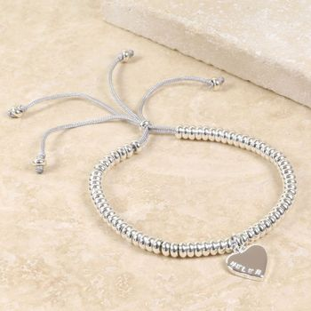 Delicate links bracelet with name in silver
