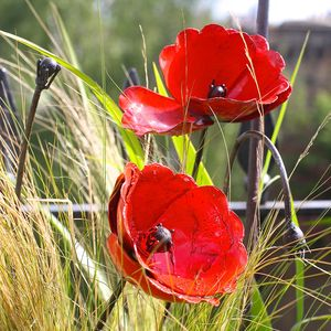 A Set Of Poppy Garden Sculptures