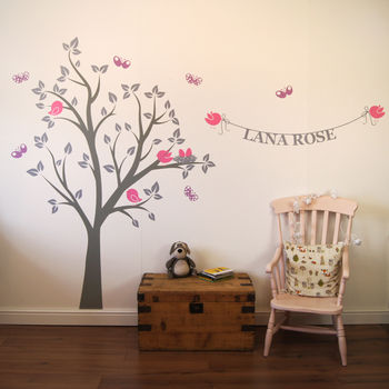 Dove grey tree, light greay leaves, lilac butterflies and pink birds