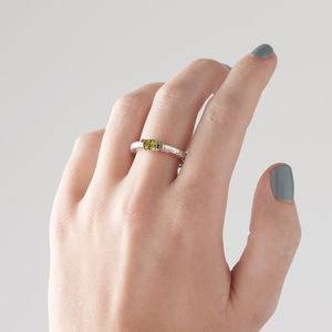 Tension Set Peridot In A Textured Silver Band - engagement rings